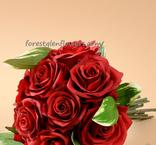 Beautiful silk wedding bouquet of deep red roses accented with varigated green leaves. www.forestglenflowers.com